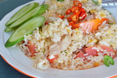 Fried rice with pork and red chili on dish Royalty Free Stock Images