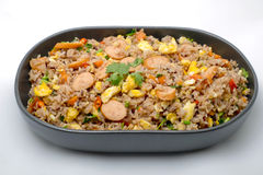 Fried rice with sausage and vegetables on white background Royalty Free Stock Photos