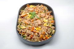 Fried rice with sausage and vegetables on white background Stock Images