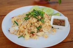 Fried rice seafood. Asian fried rice nasi goreng with chicken, prawns, and fish baso Royalty Free Stock Image