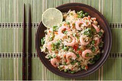 Fried rice with seafood and egg close-up, horizontal top view Stock Image