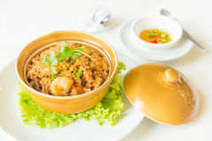 Fried rice with shrimp and sausage in clay pot Royalty Free Stock Image