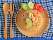 Fried rice with shrimp and squid served on a plate Stock Photo