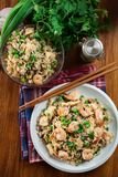 Fried rice with shrimp and vegetables served on a plate. Popular chinese dish. Top view Stock Photos