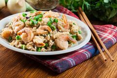 Fried rice with shrimp and vegetables served on a plate. Popular chinese dish Royalty Free Stock Photography