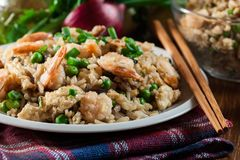Fried rice with shrimp and vegetables served on a plate. Popular chinese dish Royalty Free Stock Photo