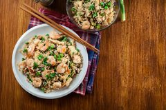 Fried rice with shrimp and vegetables served on a plate. Popular chinese dish. Top view Royalty Free Stock Photos