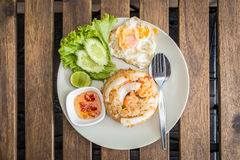 Fried rice with shrimps and fried egg. Decoration with cucumber, lemon and vegetable. Thai style food. Top view Stock Image