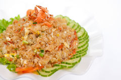 Fried rice with sliced cucumber and dried small shrimps on white. Plate deliciously Stock Image