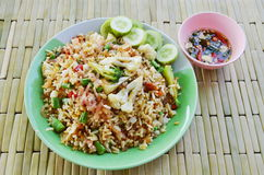 Fried rice with sour pork and vegetable on dish. Fried rice with sour pork and vegetable on the dish stock image