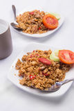 Fried rice with soy sauce, sausage and tomato. Food when working Stock Photo