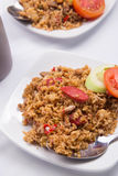 Fried rice with soy sauce, sausage and tomato. Food when working Royalty Free Stock Photo