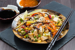 Fried rice with tofu, vegetables and sauces, close-up Royalty Free Stock Photos