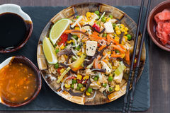 Fried rice with tofu and vegetables, top view, close-up Stock Photos
