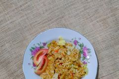 Fried rice with tomato slice royalty free stock image