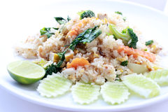 Fried rice with vegetable on the white plate with withe background. Vegetarian Food, healthy food, Thai cuisine.  Stock Photo