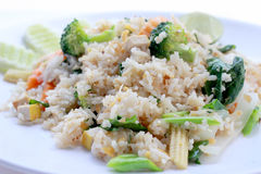 Fried rice with vegetable on the white plate with withe background. Vegetarian Food, healthy food, Thai cuisine Royalty Free Stock Images