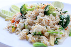 Fried rice with vegetable on the white plate with withe background. Vegetarian Food, healthy food, Thai cuisine.  Stock Image