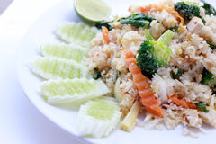 Fried rice with vegetable on the white plate with withe background. Vegetarian Food, healthy food, Thai cuisine Royalty Free Stock Photos