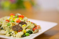 Fried rice vegetarian with peas carrots and corn Stock Photo