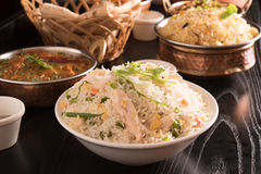 Fried rice in a white bowl with biryani and chapati. Stock Photo