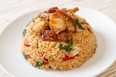 Free Fried Rice With Thai Basil And Crispy Belly Pork Royalty Free Stock Photography - 192319157