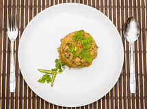 Fried rice yellow curry with pork on bamboo mat Royalty Free Stock Photo