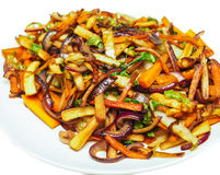 Fried root vegetables on a white plate Royalty Free Stock Photos