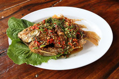 Fried ruby fish topped with sweet,sauer and hot sauce Stock Photo
