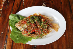 Fried ruby fish topped with sweet Royalty Free Stock Photo