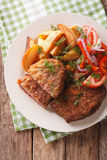 Fried rump steak and fresh vegetables, baked potatoes close up. Fried rump steak and fresh vegetables, baked potatoes close up on a plate. vertical view from Stock Image