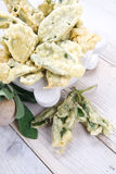 Fried sage leaves. Dish of Italian cuisine, aromatic leaves of grass, sage fried in batter with egg royalty free stock photography
