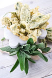 Fried sage leaves. Dish of Italian cuisine, aromatic leaves of grass, sage fried in batter with egg royalty free stock photos