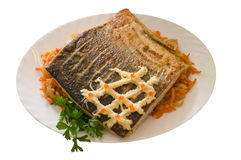 Fried salmon. The fried salmon is decorated by whipped cream and red caviar Royalty Free Stock Images