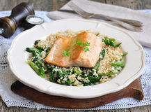 Fried salmon with brown rice, spinach and leguminous kidney bean Royalty Free Stock Photos