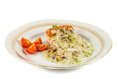 Fried salmon fillet. With blue cheese sauce royalty free stock photo