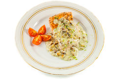 Fried salmon fillet. With blue cheese sauce stock photography