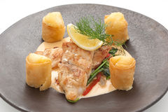 Fried salmon fillet with complex garnish Stock Images
