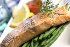 Fried salmon fillet on green beans close-up Royalty Free Stock Photos