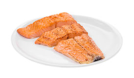 Fried salmon fillet. Isolated on a white background Stock Photos