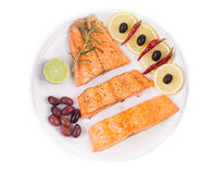 Fried salmon fillet with kalamata olives. Stock Image