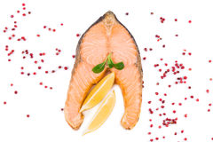 Fried salmon fillet with lemon. Royalty Free Stock Image