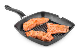 Fried salmon fillet in pan. Isolated on a white background Stock Photography