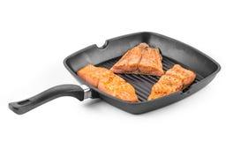Fried salmon fillet in pan. Stock Image