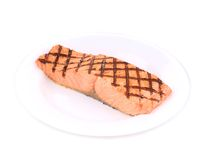 Fried salmon fillet on plate. Isolated on a white background Royalty Free Stock Image