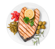 Fried salmon fillet on plate. Isolated on a white background Royalty Free Stock Photo