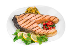 Fried salmon fillet on plate. Isolated on a white background Stock Photography