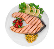 Fried salmon fillet on plate. Isolated on a white background Royalty Free Stock Photos