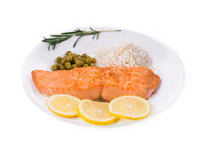 Fried salmon fillet on plate with lemon. Stock Photos