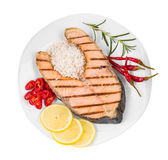 Fried salmon fillet. On plate with lemon and rice Stock Photography